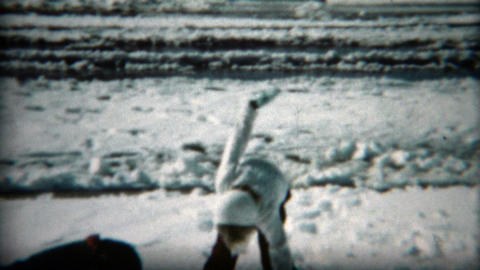 1961: Children having snowball fight in the winter sunshine as it melts Footage