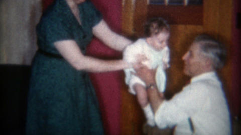 1957: Handing baby over to Grandpa results in high speed knee bouncing Footage