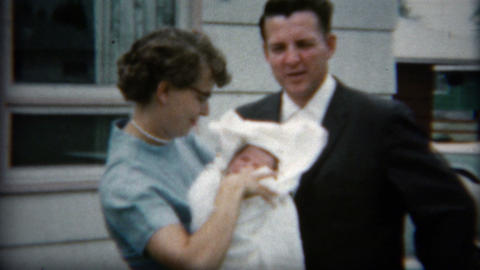 1958: 50's style parents show off new baby for first time to a camera Footage