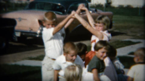1958: Game of bridges, kids passing under the arms of older children Footage