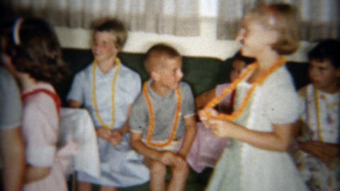 1958: Kids wearing Hawaiian style Lei necklace party Footage