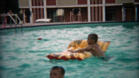 1955: Boy clowning around jumps in pool and calls mom for help Footage