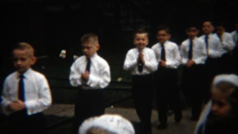 1957: Boy's 1st communion Catholic religious parading celemony outdoor Footage