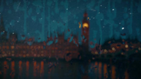 Big Ben and the Houses of Parliament seen from a window pane with falling rain Footage