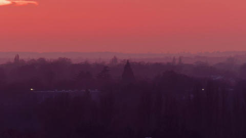 Telephoto panning shot of the picturesque winter landscape after sunset in Richm Footage
