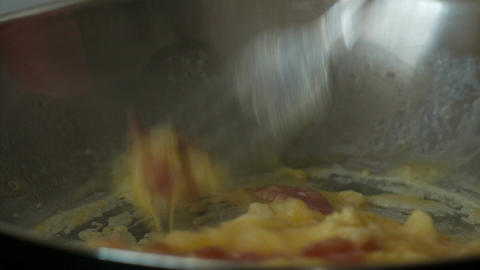 Authentic closeup food shot showing the preparation of scrambled eggs with bacon Footage