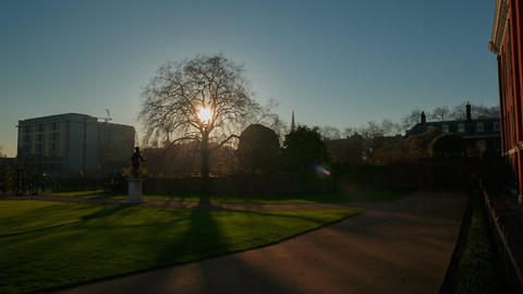 Panning shot of the Kensington Palace and gardens under a sunny cloudless sky Footage