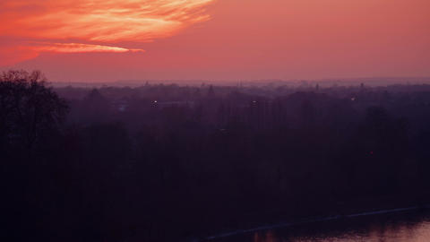Telephoto panoramic view of a misty sunset in Richmond Park, London, England, UK Footage