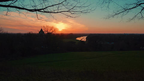 Tilting view of a winter sunset in Richmond Park, London, England, UK Footage
