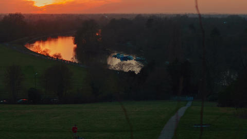 Telephoto panoramic sunset view of Richmond Park in London, England, UK Footage