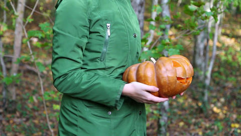 Woman holds in hands pumpkin Jack o Lantern Footage