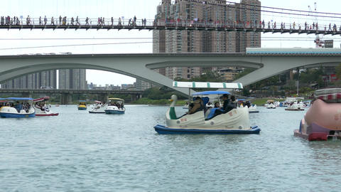 People enjoying Pedalboats on lake in Bitan New Taipei... Stock Video Footage