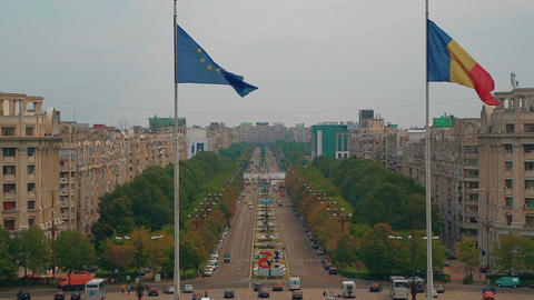 Establishing shot of the Liberty Avenue in Bucharest with the Romanian and EU fl Footage