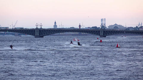 Group of men ride personal watercrafts at evening, Neva river area at evening Footage