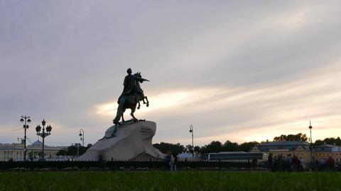 Tourist groups rush around Bronze Horseman, Senate Square timelapse at evening Footage