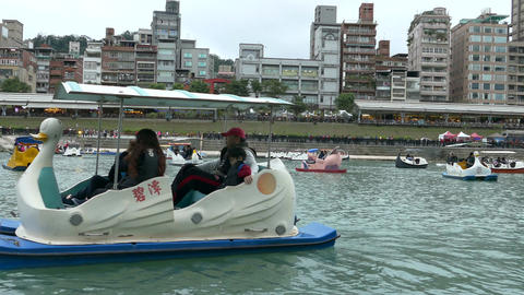 People enjoying Pedalboats on lake in Bitan New Taipei City 08 Footage