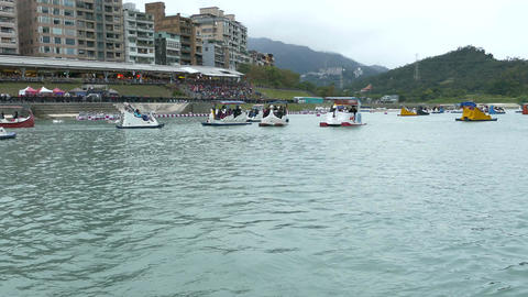 People enjoying Pedalboats on lake in Bitan New Taipei City 10 Footage