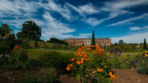 Beautiful low angle dolly shot of the Hampton Court Palace against a dramatic bl Footage