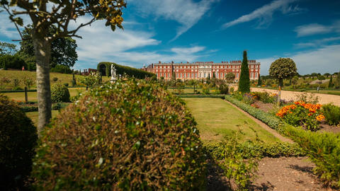 Dolly shot revealing the beautiful Hampton Court Palace in London, England, UK Footage
