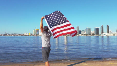 Video of man holding usa flag in real slow motion Footage