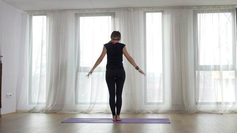 Woman doing stretching exercise in a yoga studio Footage