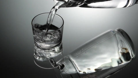 Pouring water into glass. Slow motion Footage