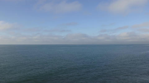 Time lapse. White clouds on the blue sky over the blue ocean Footage