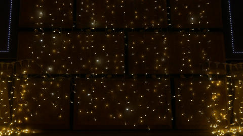 4K Ungraded: Festive Lights on Walls of Buildings European City Lights Footage