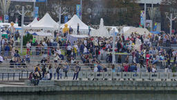 4K Ungraded: Crowd of People Walking Near River Embankment on Festive Footage