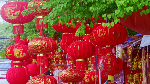 Wind Shakes Large Chinese Lanterns on Street Market Footage