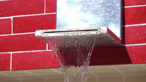 Two videos of water flowing from the public tap in real slow motion Footage