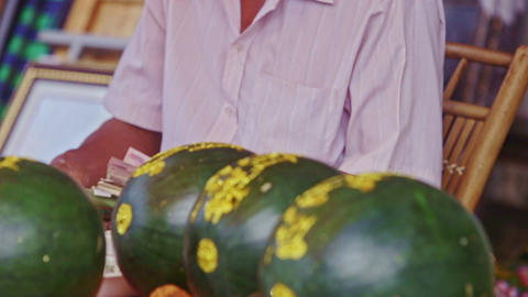 Closeup Man Gives Change to Customer at Watermelon Footage