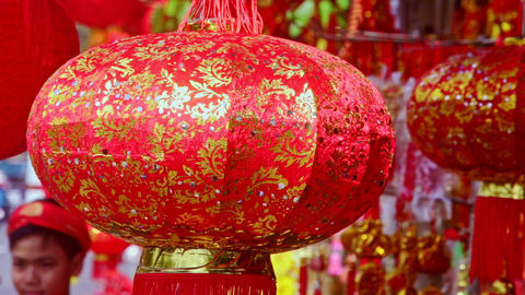 Closeup Wind Shakes Large Chinese Lantern on Street Market 影片素材