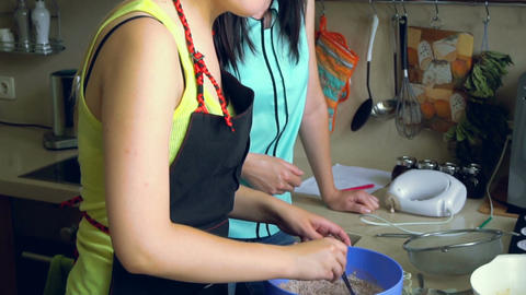 Female cook mixes ingredients for bakery Footage