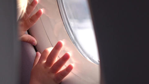 Two videos of child looking through the airplane window in 4K Footage