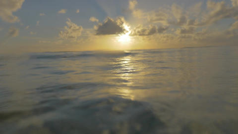 Viewing sunset from the sea water surface Image