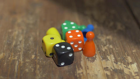 Game dice and counters on wooden table ビデオ