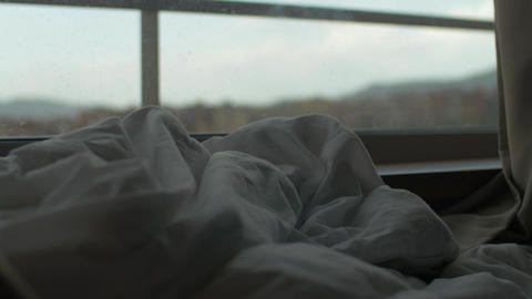 Rumpled blanket on the bed by window Footage