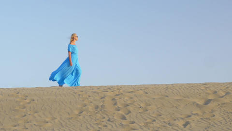 Woman walking on beach skyline Footage
