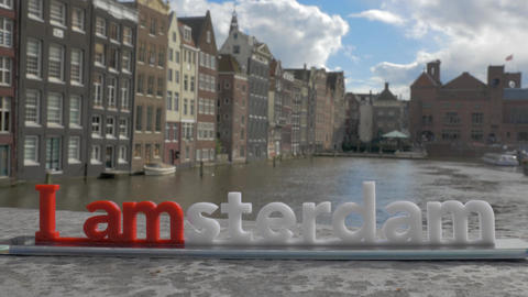 View of small plastic figure of Iamsterdam letters sculpture on the bridge Live Action
