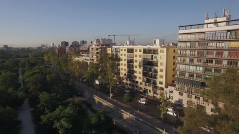 Street with park and traffic in Valencia, aerial view ビデオ