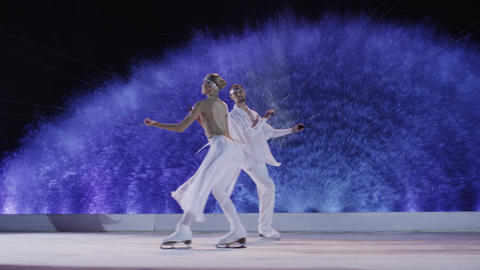 Figure skaters couple dancing on the ice with kites Footage