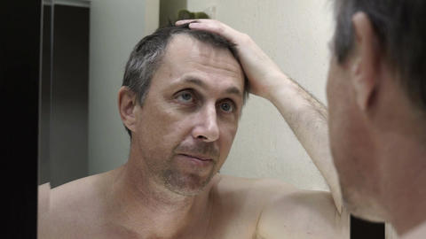Man Looking in Mirror at His Gray Hair Footage