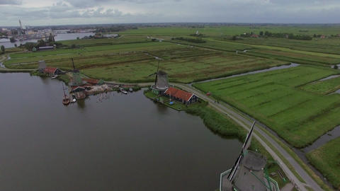 Windmills and fields in Dutch village, aerial view Footage