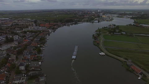 Aerial view of town and river with sailing ship, Netherlands Footage