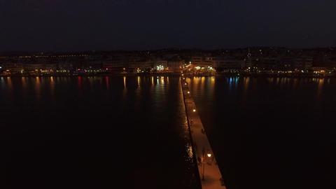 Aerial night view of resort and pier in the sea Footage