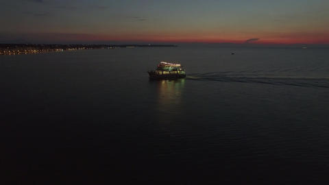 Aerial view of sailing touristic ship at night Bild