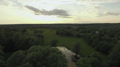 In the countryside at sunset, aerial view Live Action