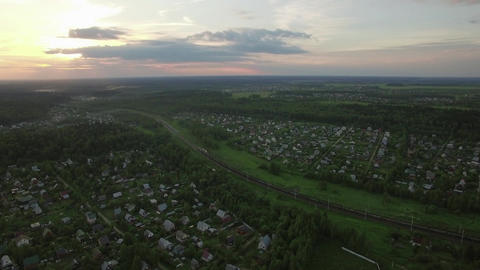 Russian village and moving cargo train, aerial view Footage