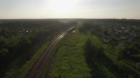 Train in the countryside, aerial view Footage